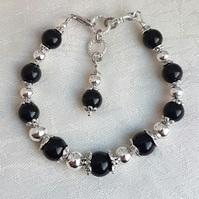 Beautiful Darkness and Light Bracelet - Silver tones.