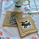 Pair of coasters - cat and dog