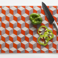 Glass chopping board or worktop saver in vibrant orange white and grey