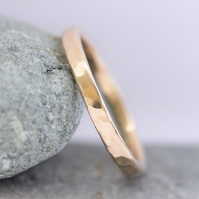 Recycled 9ct red gold hammered wedding band 2mm wide.