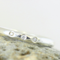 Recycled, sterling silver ring with three moissanite gems, 2 mm wide, ethical