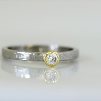 Palladium planished band with yellow gold setting and 3mm diamond.