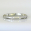 Sterling silver frosted band with ten diamonds.