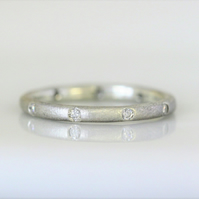 Recycled, sterling silver band with ten diamonds, 2 mm wide ,ethical jewellery