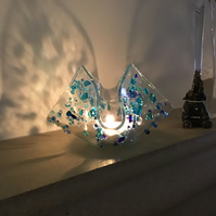 Fused glass candle crib with jewels of blues and turquoise