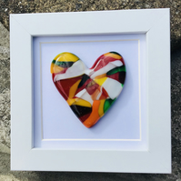 Fused glass cast heart in box frame .