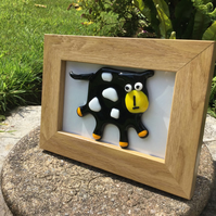 Quirky and fun 3 dimensional glass cow picture in wood frame