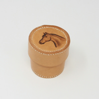 Small round leather trinket box with horse's head motif