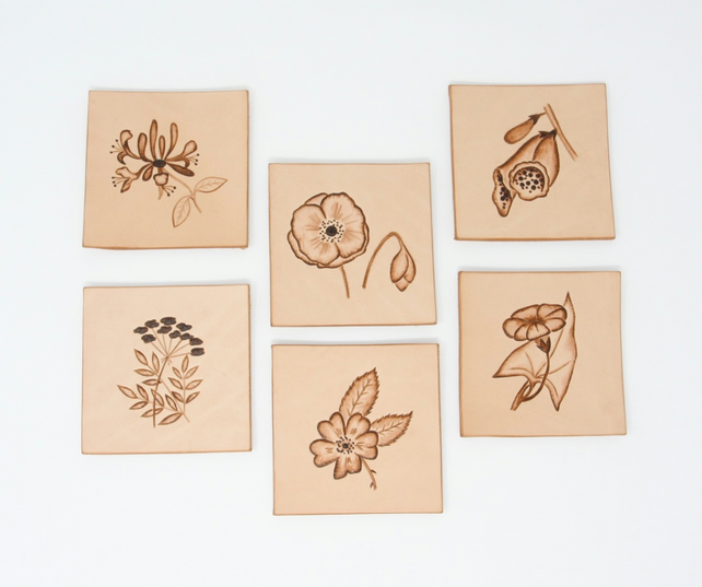 Set of six leather coasters with hedgerow motifs