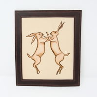 Boxing hares framed leather picture