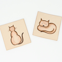 Pair of leather drinks coasters - with hand-painted cat motifs