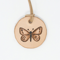Leather pendant with butterfly motif