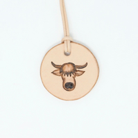 Leather pendant with highland coo motif