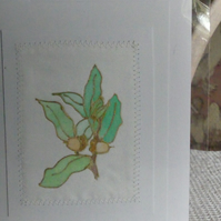 Acorns on a twig with leaves, hand painted on silk, greetings card
