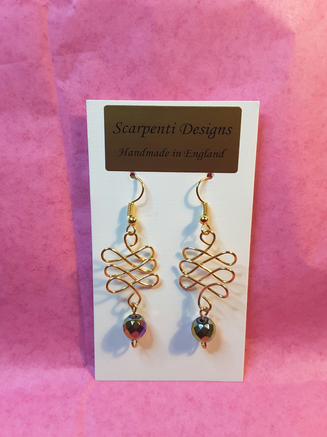 Gold plated wire and hematite Celtic design chandelier earrings