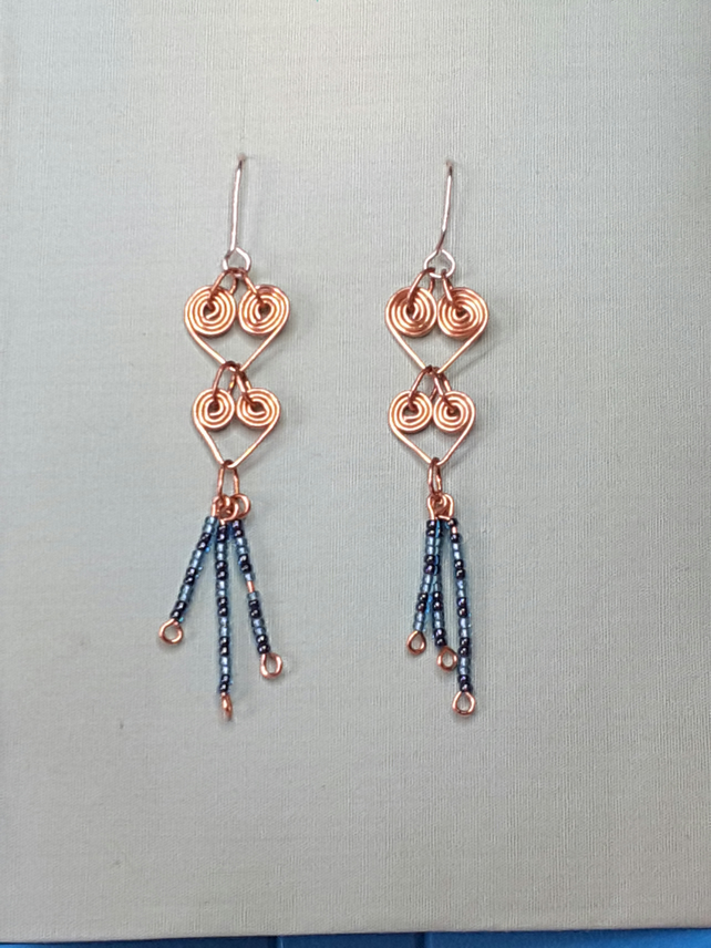 Egyptian coil and bead dangle chandelier earrings in copper