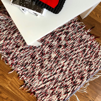 Black, white and red rag rug