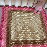 Baby girl crochet blanket-perfect baby shower gift made to fit a cot.