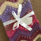 Gorgeous crochet baby blanket for a girl - perfect for a Moses basket.