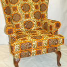 ONE OFF DESIGN UPCYCLED WING CHAIR IN VIBRANT YELLOW AND ORANGE ETHNIC PRINT