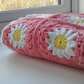 Pink and white daisy crochet blanket