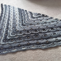 Crochet virus shawl in shades of grey