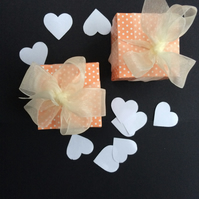 Two small hand cut peach and white polka dot gift boxes