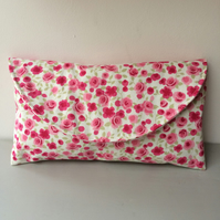 Clutch bag in vintage style pink roses on a white background