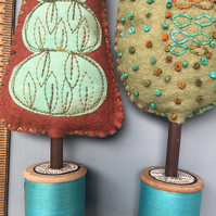 Pair of cotton reel trees