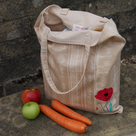 Eco-friendly tote bag with appliqued poppy