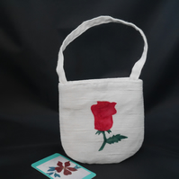 Small wristlet bag with appliqued red rose, flower girl purse