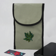 Pale green fabric phone pouch with appliqued leaf