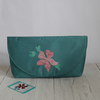 Envelope style clutch bag with appliqued floral design