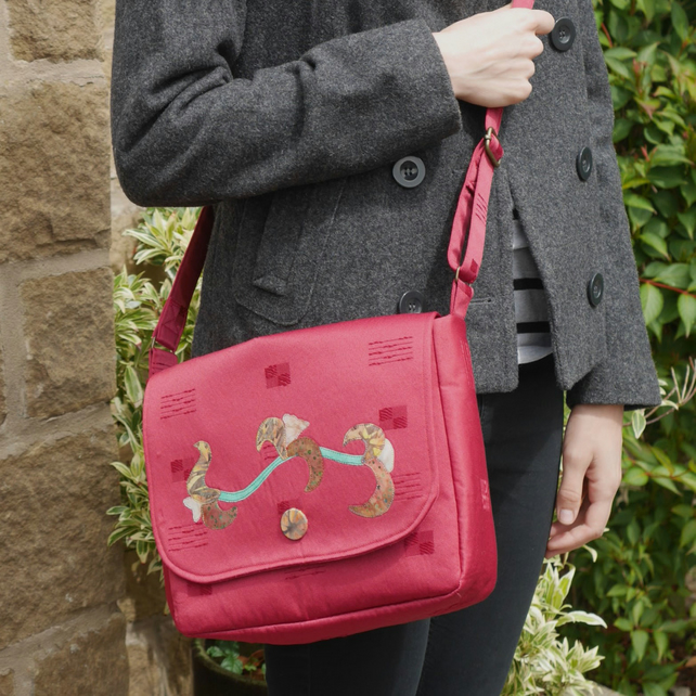 Messenger style crossbody bag made from deep red upcycled fabric