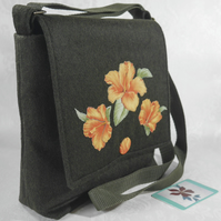 Crossbody bag with orange appliqued floral design