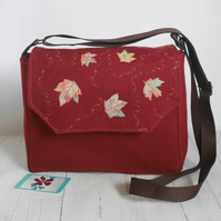 Wool messenger style crossbody bag with appliqued leaves and machine embroidery