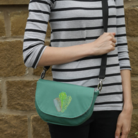 Green saddle bag with appliqued cacti, 3-way purse
