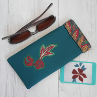 Green flex frame glasses case with appliqued design and contrast trim