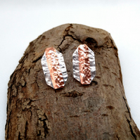Handmade sterling silver and copper stud earrings.