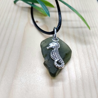 Green sea glass necklace with seahorse charm.