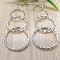 Handmade triple hoop sterling silver earrings.