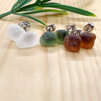 Three pairs of sea glass stud earrings.