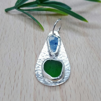 Handmade sterling silver sea glass and sea pottery pendant.