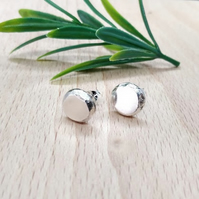 Sterling silver nugget stud earrings.