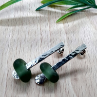 Sterling silver bar stud earrings with green sea glass.