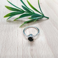 Textured handmade sterling silver green sea glass ring.