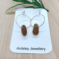 Dark amber coloured genuine sea glass on sterling silver hoops and fittings.