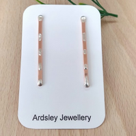 Copper and silver smudge drop stud earrings.