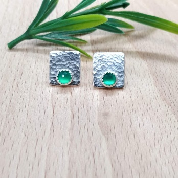 Handmade hammered stud earrings with rose cut green onyx stones.