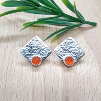 Stud earrings with orange carnelian stones.